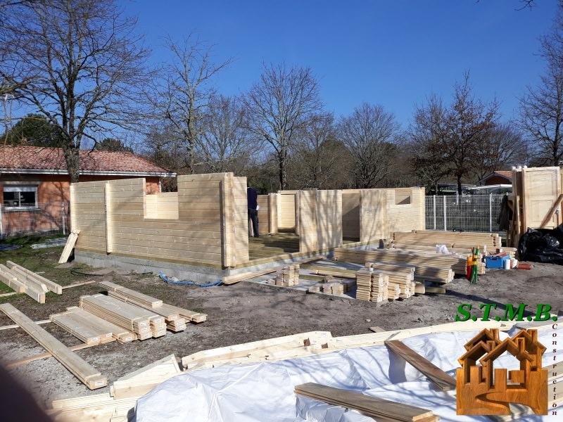 Construire en bois avec l aide des maisons en kit stmb for Construction maison en kit bois