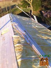 Isolation de la toiture  chalet en bois stmb construction
